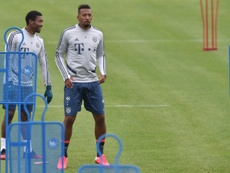 David Alaba (L) is eager to get back playing again. AFP