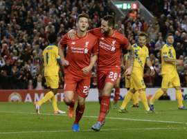 Liverpools midfielder Adam Lallana (L) celebrates with striker Danny Ings after scoring the opening goal of a UEFA Europa League group B football match against FC Sion at Anfield in Liverpool, north west England on October 1, 2015