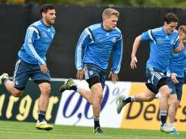 (L-R) Kevin Volland, Matthias Ginter, Sebastian Rudy and Marco Reus of the German national football team run during a training session in Frankfurt am Main on October 6, 2015, prior to the EURO qualifier against Irleand on October 8, 2015, in Dublin