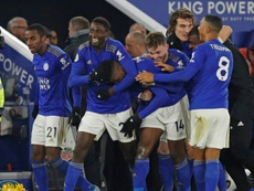 Iheanacho (C) was the hero for Leicester with a late winner. AFP