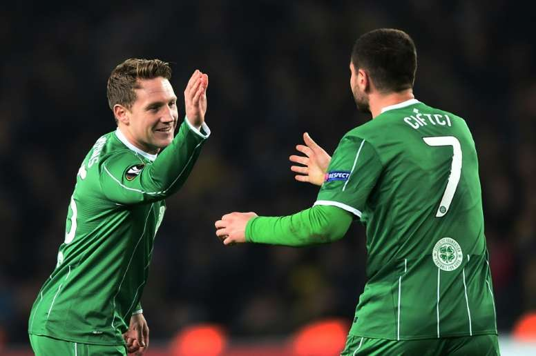 Celtics Kris Commons (L) celebrates with Nadir Ciftci after scoring during the UEFA Europa League football match between Fenerbahce and Celtic in Istanbul on December 10, 2015