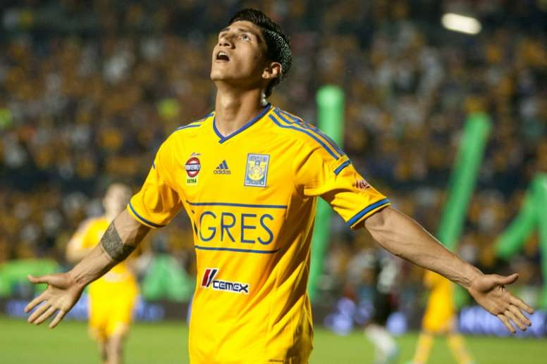 d70c89a2084 Pin Tigres Alan Pulido celebrates after scoring against Atlas during their  2014 Mexican Clausura tournament football match