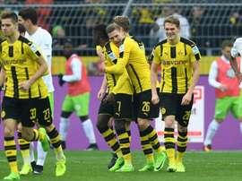 Les joueurs du Borussia Dortmund célèbrent un but contre Wolfsburg en Bundesliga. AFP