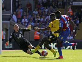 Crystal Palace's French midfielder Bakary Sako (R) has an attempt blocked by Aston Villa's Micah Richards (2nd R) during the English Premier League football match in south London on August 22, 2015