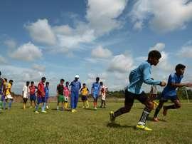 Under-privileged Indian schoolboys practice their football skills at The Durbar Sports Academy in Ramnagar