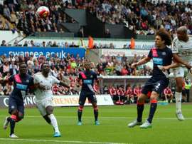 Swansea Citys French-born Ghanaian striker Andre Ayew (R) scores from a header past Newcastle Uniteds Argentinian defender Fabricio Coloccini during the English Premier League football match in Swansea, south Wales on August 15, 2015