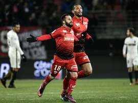 Dijons French midfielder Frederic Sammaritano (L) celebrates after scoring a goal during the French L1 football match Dijon vs Monaco on November 29, 2016