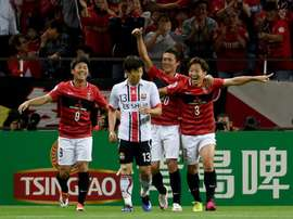 Tomoya Ugajin (R) celebrates scoring against FC Seoul in the AFC Champions League on May 18, 2016