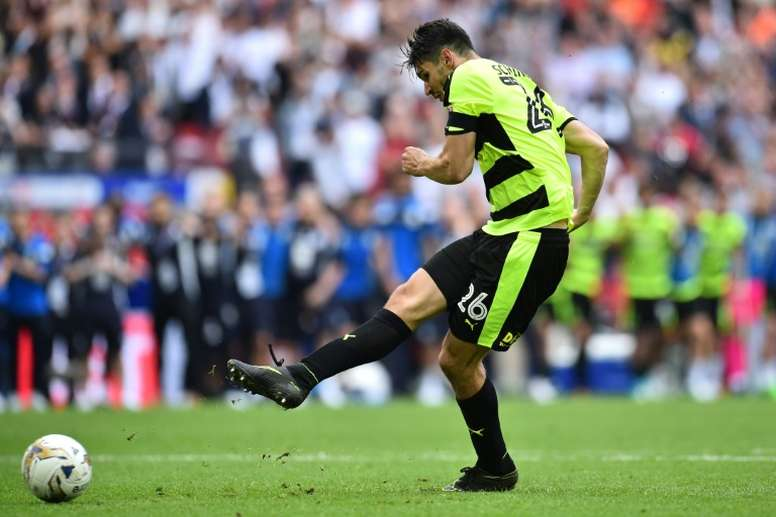 Huddersfield beat Reading on penalties in the Championship play-off final at Wembley in May. AFP