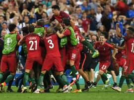 Portugals forward Eder (C) celebrates with teammates after he scored during the Euro 2016 final football match between Portugal and France at the Stade de France in Saint-Denis, north of Paris, on July 10, 2016