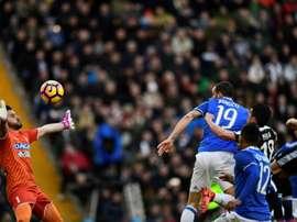 Leonardo Bonucci heads to score during the match Udinese vs Juventus. AFP