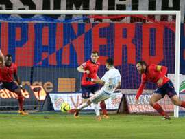 Marseilles midfielder Remy Cabella (C) shoots and scores a goal during a French L1 football match against Gazelec Ajaccio on March 9, 2016