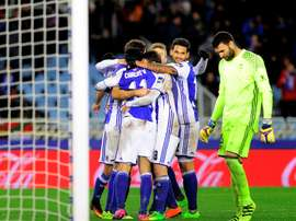 Real Sociedad players celebrate their team's win. Goal