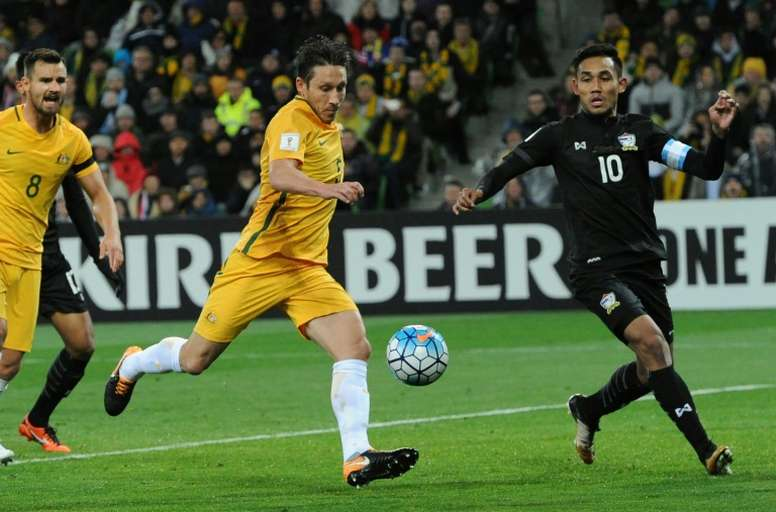 Australia edged past Thailand to keep their World Cup dreams alive. AFP