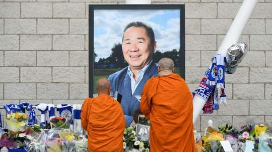 Buddhist monks lay tributes by a photograph of Leicester City chairman Vichai Srivaddhanaprabha. AFP