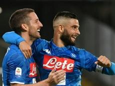Mertens (left) scored a hat-trick for Napoli. AFP