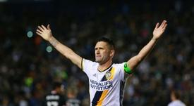 Keane cambia el terreno de juego por los banquillos. AFP