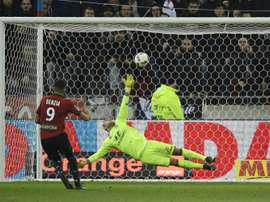 Lille's Yassine Benzia scoring against his former team. AFP
