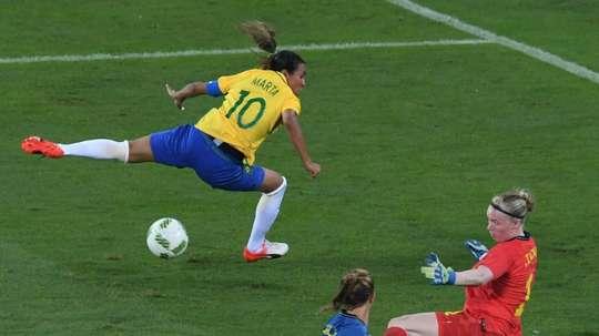 Marta (left) shoots past Swedens goalkeeper Lindahl Hedvig in Rio on August 6, 2016