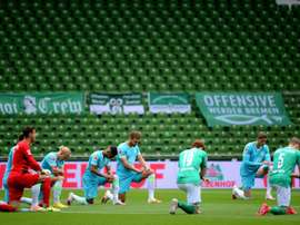 Werder slip towards drop as teams take knee for Floyd protests. AFP
