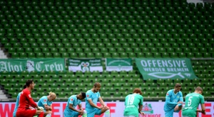 Werder slip towards drop as teams take knee for Floyd protests. AFP