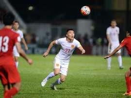 Chinas Yu Dabao (C) during the 2018 FIFA world cup qualifier against Hong Kong at Mong Kok stadium in Hong Kong on November 17, 2015