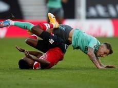 Everton defender Lucas Digne (right) fouls Southamptons Kyle Walker-Peters. AFP