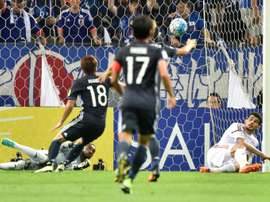 United Arab Emirates (UAE) goalkeeper goalkeeper Khalid Eisa (bottom left) blocking a shot. AFP