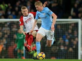 McClean pictured battling against Kevin de Bruyne. AFP
