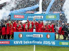Feyenoord Rotterdams players celebrate with the trophy on the podium after winning the Dutch cup final football match against FC Utrecht, on April 24, 2016