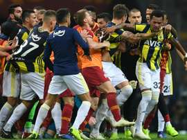 Fenerbahce and Galatasaray players fought at end of derby. AFP