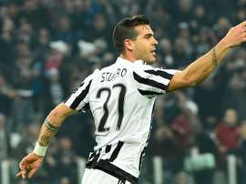 Juventus midfielder Stefano Sturaro celebrates after scoring a goal during the UEFA Champions League match against Bayern Munich in Turin on February 23, 2016