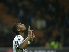 Juventus midfielder from France Paul Pogba celebrates after the Italian Serie A football match AC Milan vs Juventus on April 9, 2016 at the San Siro Stadium stadium in Milan
