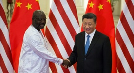 Weah pictured with China's General Secretary of the Communist Party, Xi Jinping. AFP