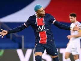 Blue-haired Mbappe helps PSG keep pace with Lille ahead of Sunday clash. AFP