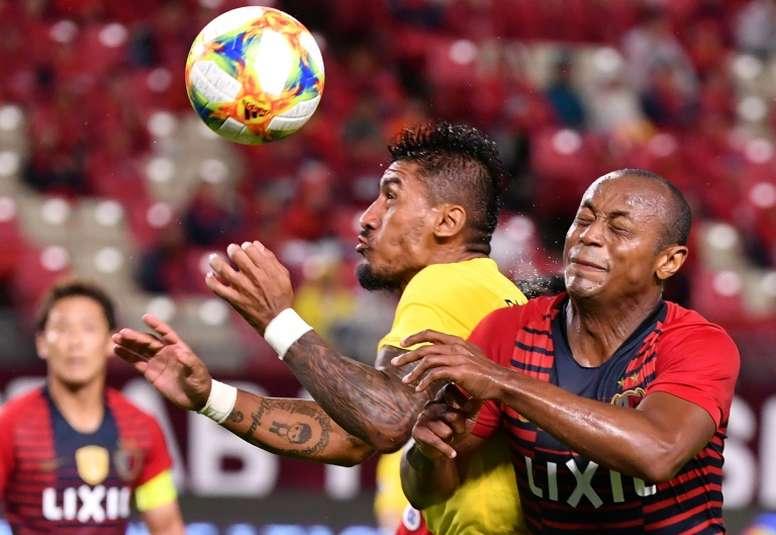 Benitez, Paulinho back to China and into coronavirus quarantine. AFP