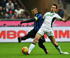 Acerbi vying for the ball with Inter's Mauro Icardi. AFP