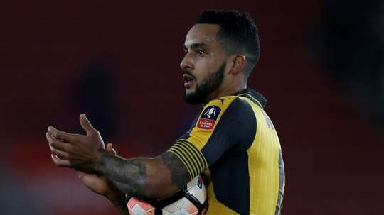 Walcott in FA Cup action for Arsenal. AFP