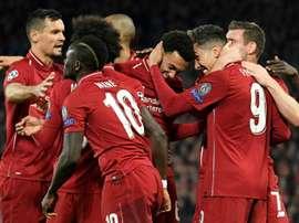 Melhor jogador e treinador do mês de março para o Liverpool. AFP