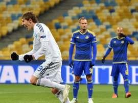 Dynamos midfielder Denys Garmash (L) celebrates after scoring during a UEFA Champions League match against Maccabi Tel-Aviv on December 9, 2015