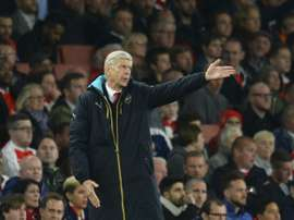 Arsenals French manager Arsene Wenger reacts on the touchline during the UEFA Champions League Group F football match between Arsenal and Olympiakos at The Emirates Stadium in north London on September 29, 2015