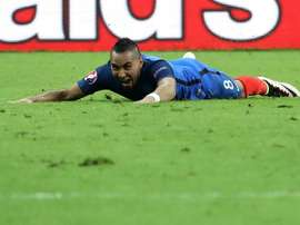 Frances forward Dimitri Payet celebrates after scoring Frances second goal during the Euro 2016 group A football match between France and Romania at Stade de France, in Saint-Denis, north of Paris, on June 10, 2016