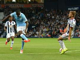 Manchester Citys Yaya Toure (L) scores from a deflection during their English Premier League match against West Bromwich Albion, at The Hawthorns in West Bromwich, central England, on August 10, 2015