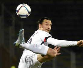 Paris Saint-Germains Swedish forward Zlatan Ibrahimovic kicks the ball during the French L1 football match Lorient against Paris Saint Germain on November 21, 2015 at the Moustoir stadium in Lorient, western France