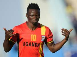 Uganda's Luwagga Kizito celebrates after scoring a goal during their CAF qualifyer. AFP