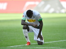 Gladbach 'flabbergasted' by racist fans and tells them to leave. AFP