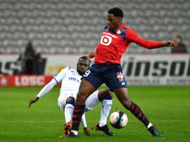 Jonathan David (R) scored the goal which allowed Lille to keep pace in the Ligue 1 title race.AFP
