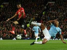 Marcus Rashford urges United to play like a team. AFP