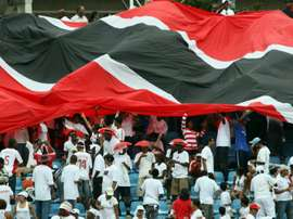 Trinidad insist US game on despite water-logged pitch. AFP