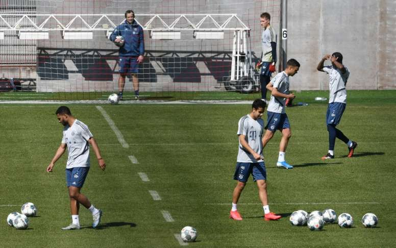 Bayern Munichs players resumed training with restrictions. AFP